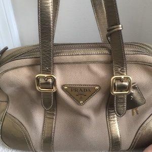 Prada bowing metal purse